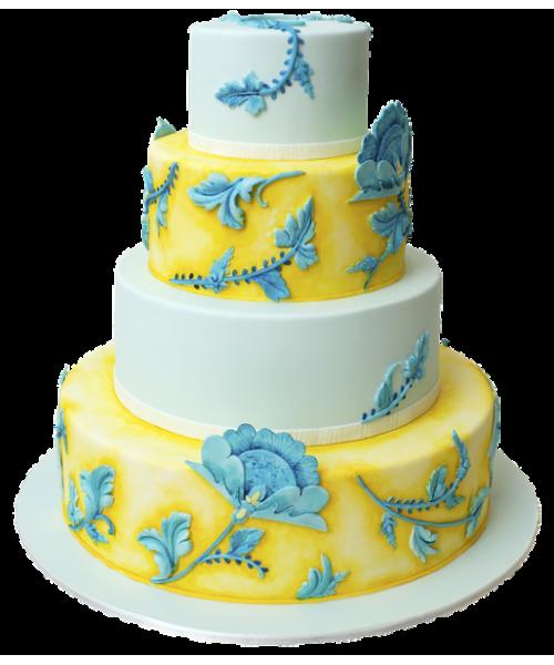 Четырех ярусный свадебный торт в белом и желтом цвете украшен цветами