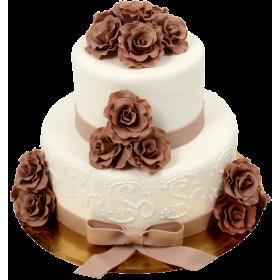 Двухъярусный свадебный торт в белом цвете с коричневыми цветами из мастики