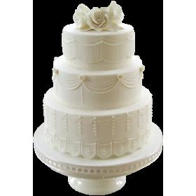 Белый трехъярусный свадебный торт с цветком сверху