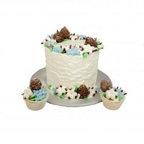 Белый одноярусный свадебный торт с капкейками,украшенными ягодами и шишками из мастики