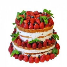 Открытый свадебный торт в два яруса украшенный свежей клубникой